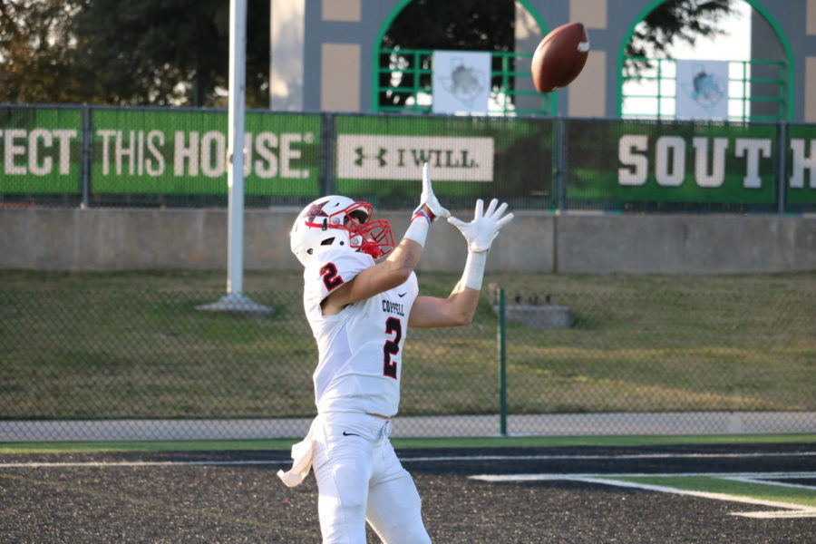 Coppell senior wide receiver Tanner Woodby reaches up to make a catch for a touchdown in the fourth quarter at Dragon Stadium on Nov. 17. The Carroll Dragons ended the game, 54-10, over Coppell, ending the Cowboys' season.