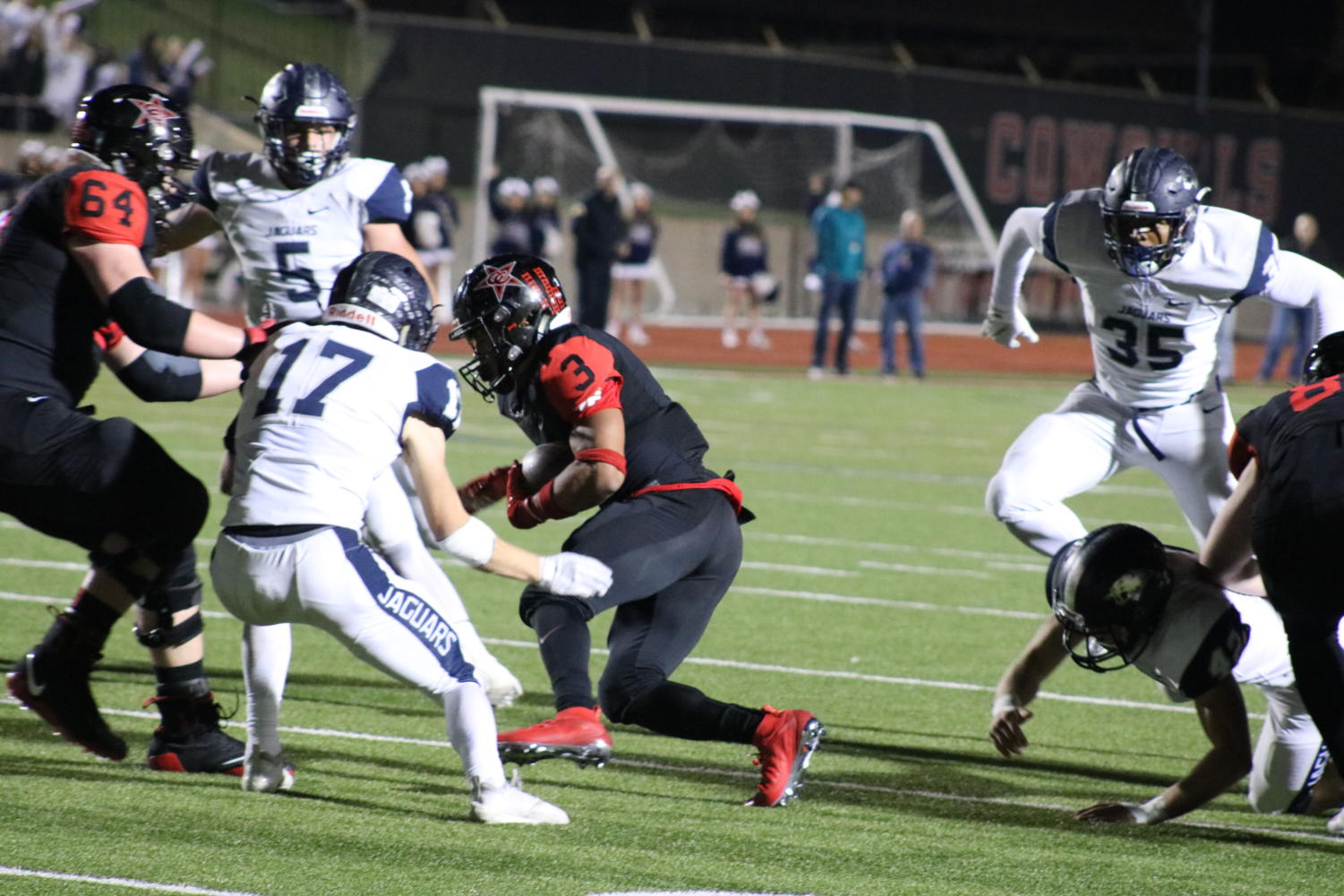Coppell senior wide receiver Jonathan McGill attempts to run around the Flower Mound defense last Friday night. The Cowboys lost to the Jaguars, 31-17, at Buddy Echols Field.