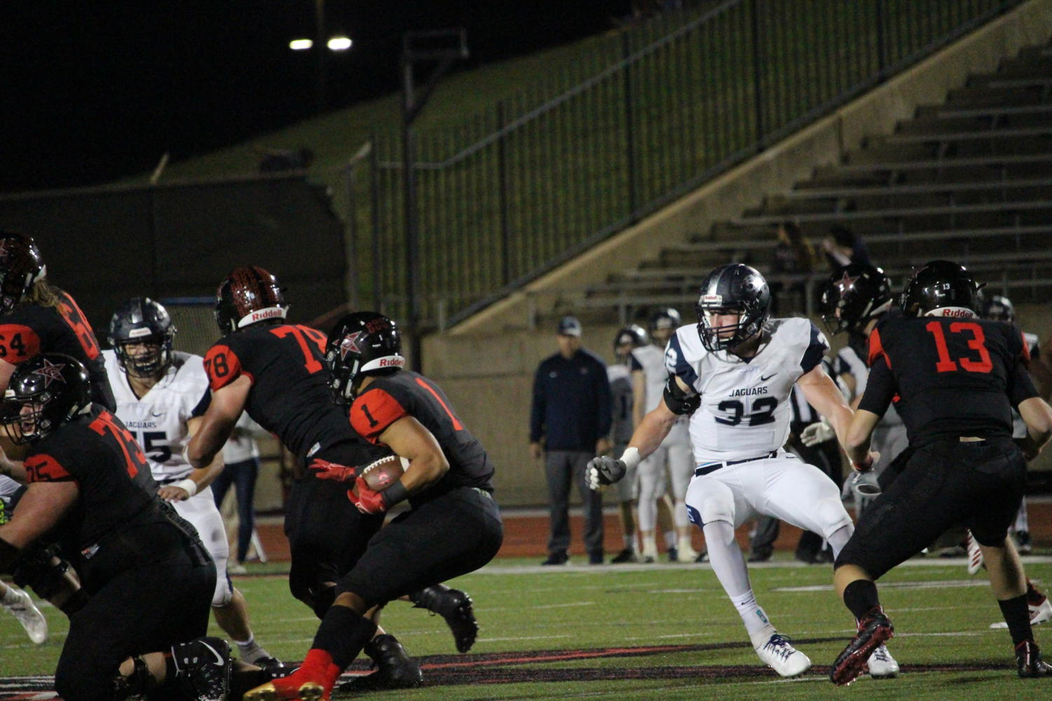 Coppell senior De Heath carries the ball to score a touchdown on Friday Nov. 2 at Buddy Echols Field. The Cowboys lost to Flower Mound, 31-17.