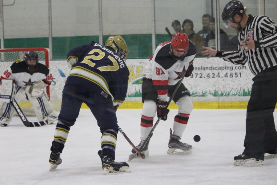 Trevor+Moore+and+his+opponent+fight+for+the+puck+at+the+face+off+on+Nov.+15+at+Dr+Pepper+StarsCenter+in+Farmers+Branch.+Coppell+hockey+lost+to+Jesuit+4-2.+