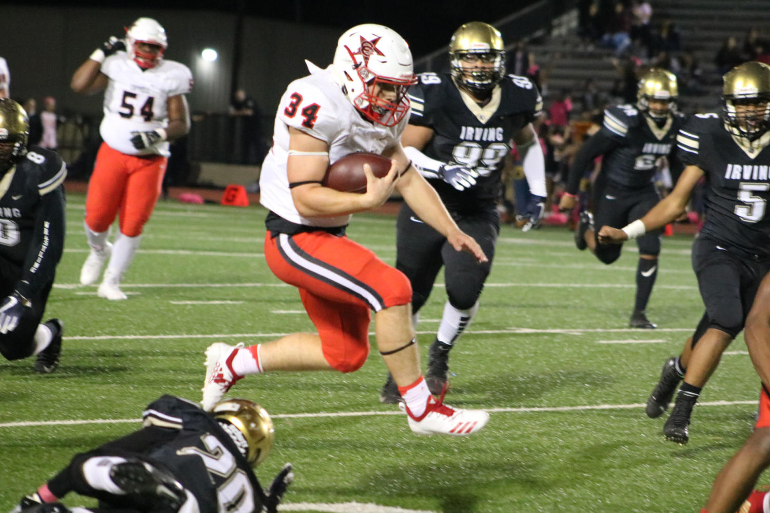 Coppell senior running back Ryan Hirt runs the ball towards Cowboys end zone during the game at Joy & Ralph Ellis Stadium on Oct. 26. The Coppell Cowboys defeated the Irving Tigers 48-13.