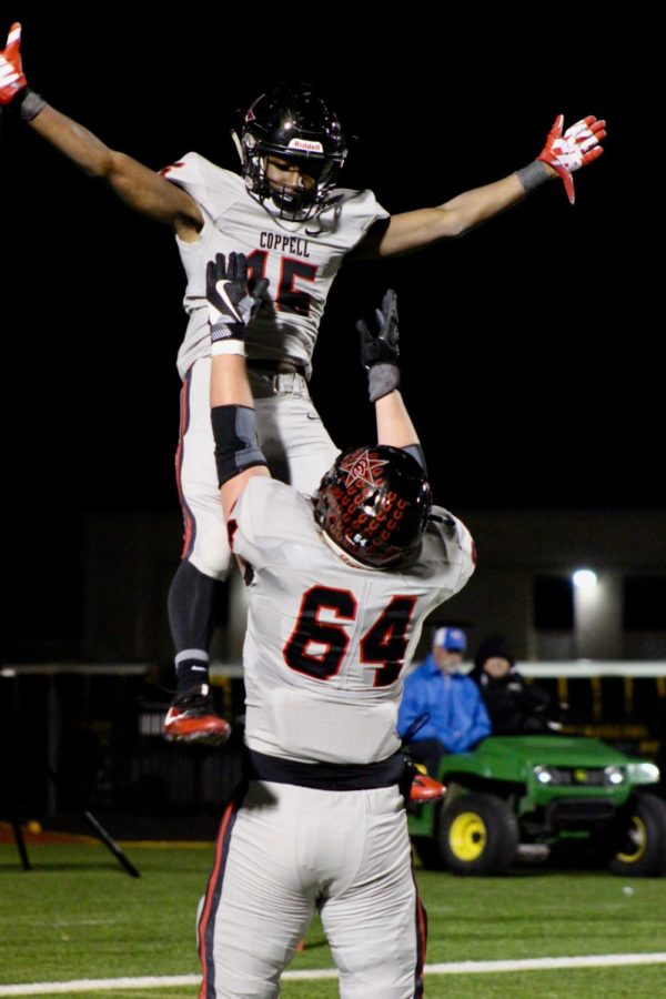 Coppell High school senior Trevor Stange and sophomore running back Jason Ngwu celebrate a touchdown during the game on Nov 9 at Joy and Ralph Ellis Stadium. The Cowboys beat the Vikings, 35-14.