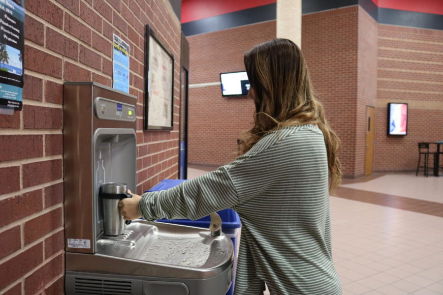 Coppell High School sophomore Lauren Mun uses the new addition of water fountains located near the CHS cafeteria which was Coppell High School's campus senior gift from the graduating class of 2017. The water fountains have promoted students bringing reusable water bottles to school.