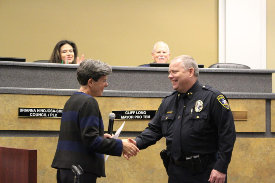 During the Coppell City Council meeting on Dec. 12, Mayor Karen Hunt swears in new Police Chief Danny Barton. City chairs Brianna Hinojosa-Smith and Cliff Long, as well as other members of the council, are present as Barton is officially sworn in during the public ceremony.