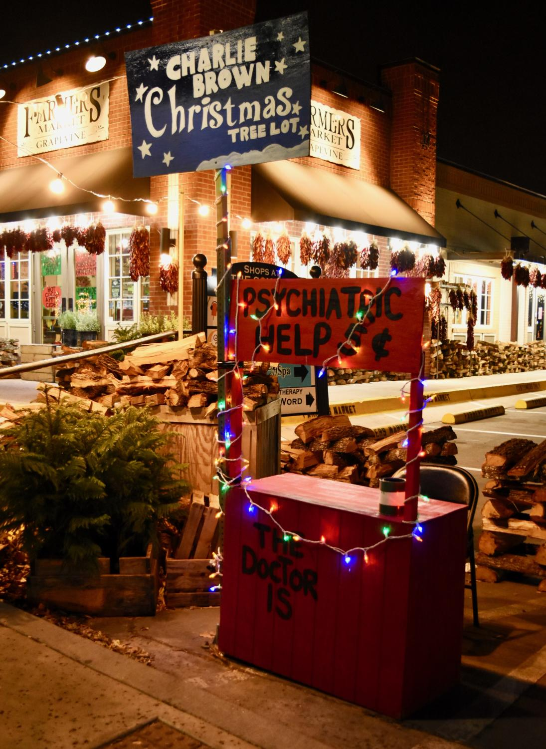 Grapevine+store+owners+have+put+effort+into+making+Main+Street+fun+and+festive+with+the+iconic+Charlie+Brown+Christmas+psychiatric+help+booth+for+visitors+to+take+photos+in.+Grapevine+is+known+for+its+name+%E2%80%9CThe+Christmas+Capital+of+Texas%E2%80%9D+for+their+annual+decorations%2C+parade%2C+and+the+North+Pole+Express+train.