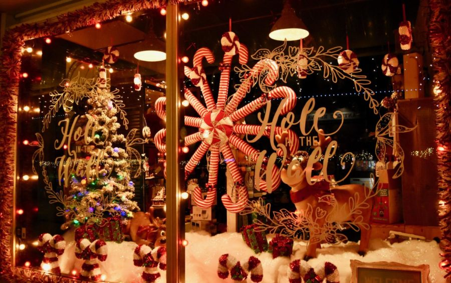 "A storefront along Main Street of Grapevine sparkles with lights and festive Christmas decorations to celebrate the holiday season. Grapevine is known for its name ""The Christmas Capital of Texas"" for its annual decorations, parade, and the North Pole Express train."