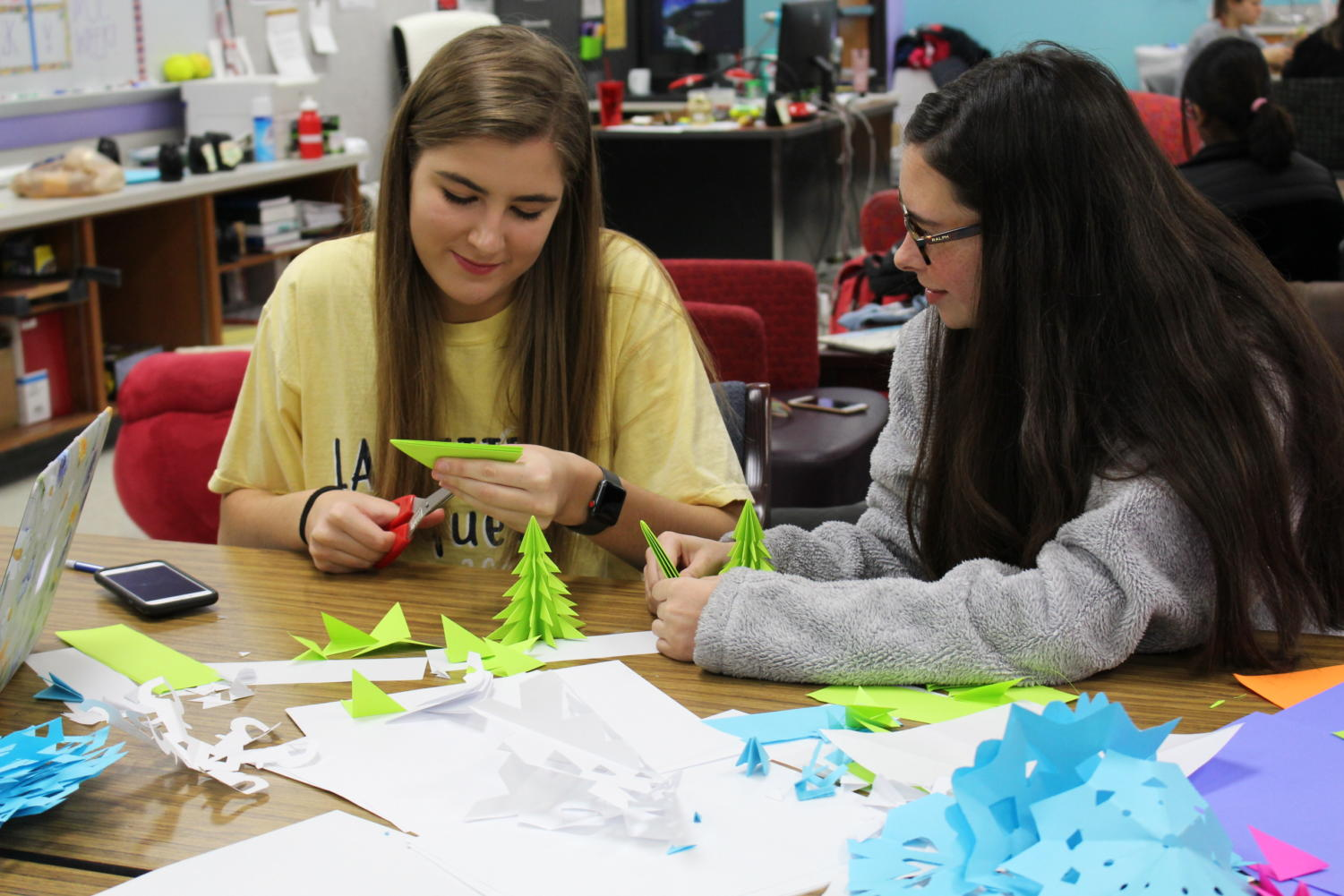 During seventh period, Coppell High School seniors Amanda Lasky and Kaitlyn Sork make Christmas trees for the centerpiece of the teacher luncheon. The Student Council teacher luncheon will be held on December 20 at 1:15pm in the Large Commons.