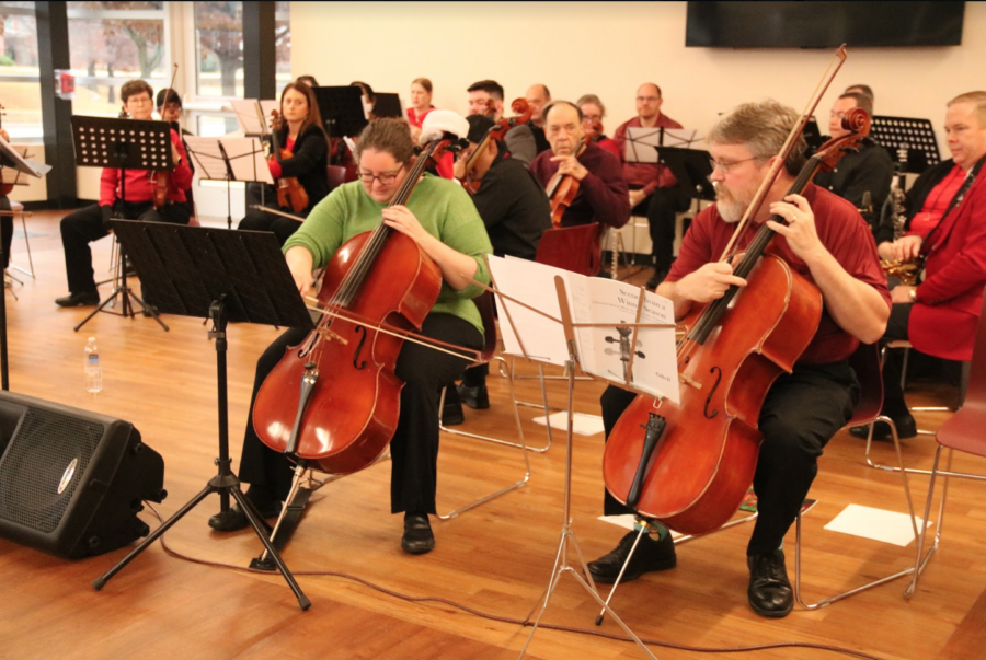 "The Coppell Orchestra performed at the Cozby Public Library on Saturday. President Tina Brown and another member of the group play ""In the Bleak Midwinter"" by Holst."