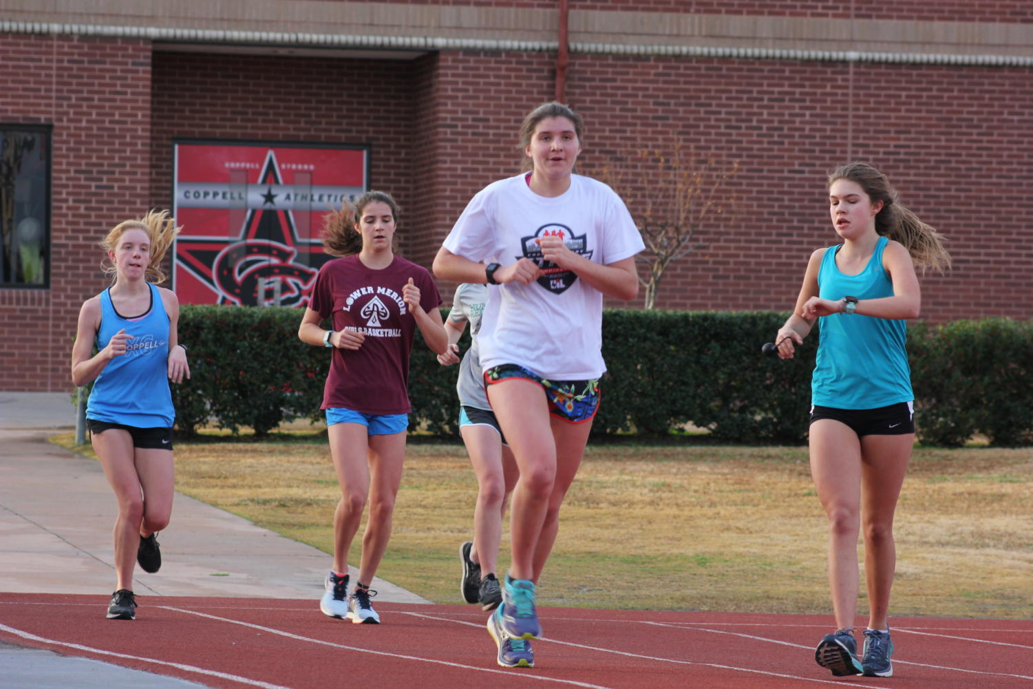 Coppell High School girls Cross Country team returns back to the track after their daily morning run on Dec. 4. Girls Cross Country recently won the 2018-2019 State Championship at Old Settlers Park in Round Rock Texas.