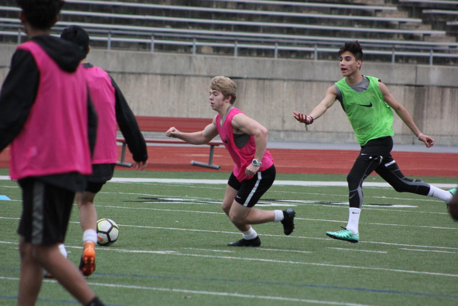 Coppell High School seniors Blake Bartlett, and Jacob Vasquez scrimmage against each other during practice before school on Buddy Echols Field on Dec. 17. The Cowboys soccer teams first game is Dec. 28th against Sam Houston at Buddy Echols Field at 2:00pm