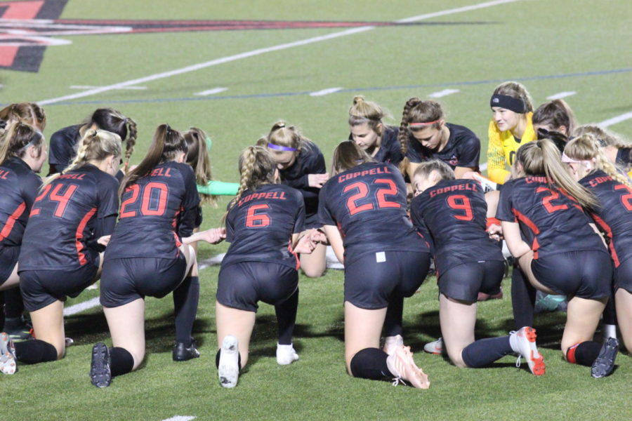 Coppell Cowgirls gathers up to prepare for their game against Hebron on Jan. 25 at Buddy Echols Field. The Cowgirls won again Hebron 2-0.