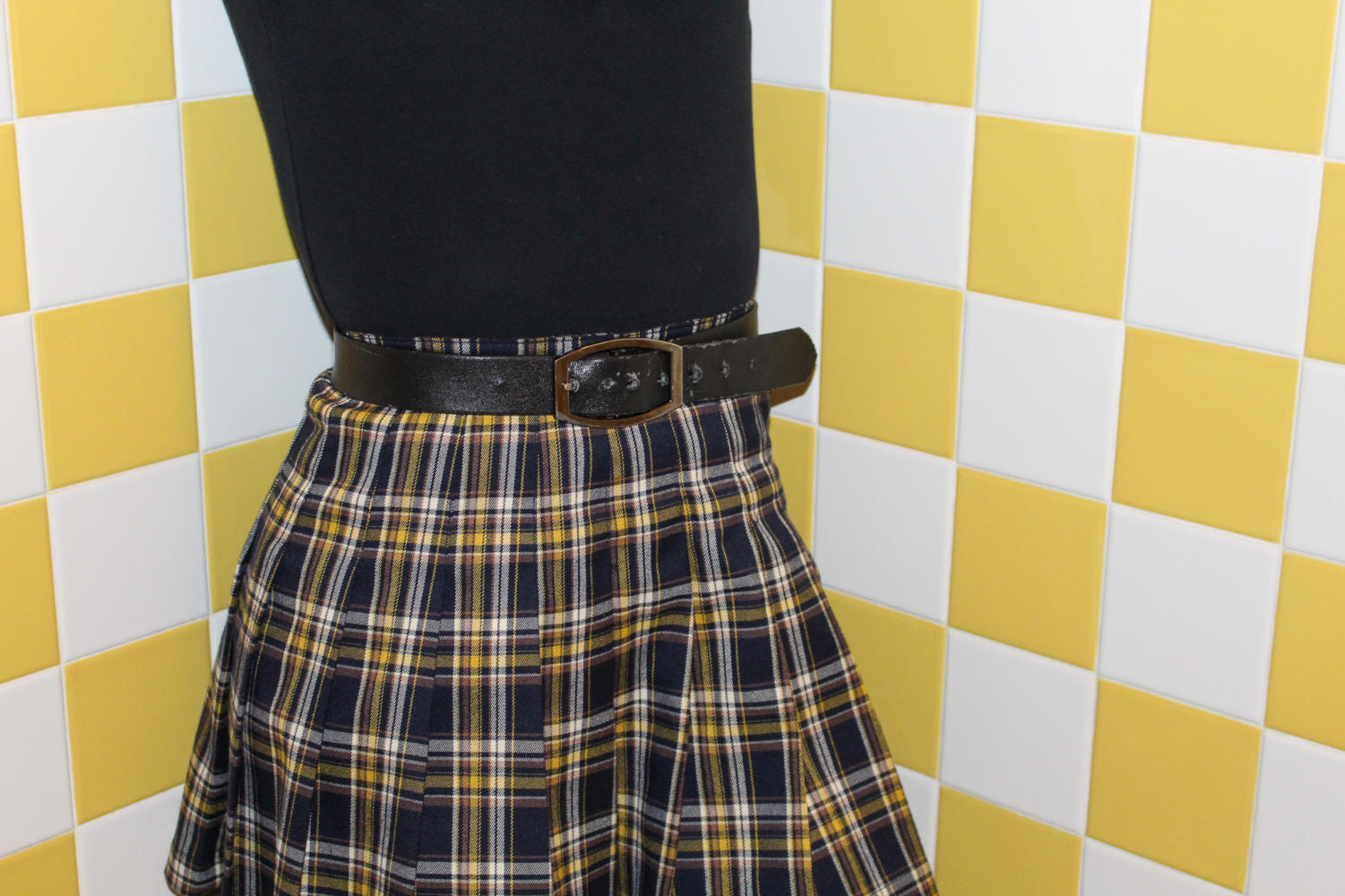 Plaid's vintage look is a current fashion trend worn by many Coppell High School students. This tartan skirt was purchased at Forever 21.