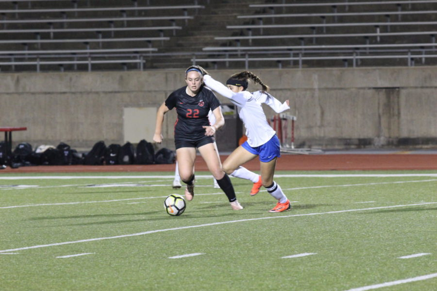 Coppell sophomore Maya Ozymy runs after the ball and dribbles upfield against Hebron on Jan. 25 at Buddy Echols Field. The Cowgirls won again Hebron 2-0.