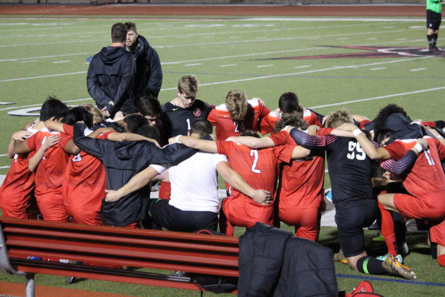 The Coppell High School Varsity Soccer team prepares for their match against Keller Timber Creek by huddling in a circle on Friday at Buddy Echols Field. The Cowboys play Marcus on Friday at 7:30 p.m. at Buddy Echols Field.