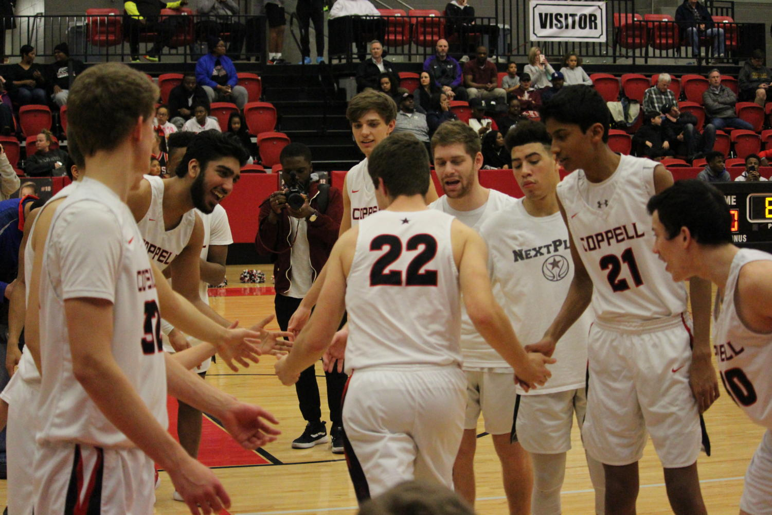Coppell junior Dan Igrisan high fives his fellow teammates as an introduction on Tuesday Jan 22 at CHS arena. The Coppell Cowboys lost to the Lewisville Farmers 71-57.
