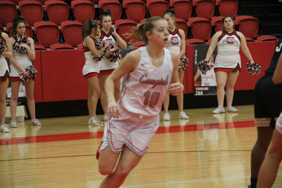 Coppell sophomore Emma Sherrer runs to keep her eyes on the ball on Tuesday Jan. 29 at the CHS arena. The Coppell Cowgirls defeated the Irving Tigers 75-36.