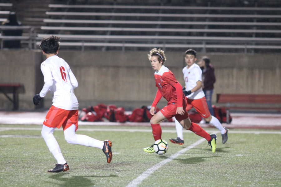 Coppell midfielder Sebastian Blaas dribbles upfield during the match against Macarthur on Jan. 22 at Buddy Echols Field. The Cowboys defeated Cardinals 5-1.