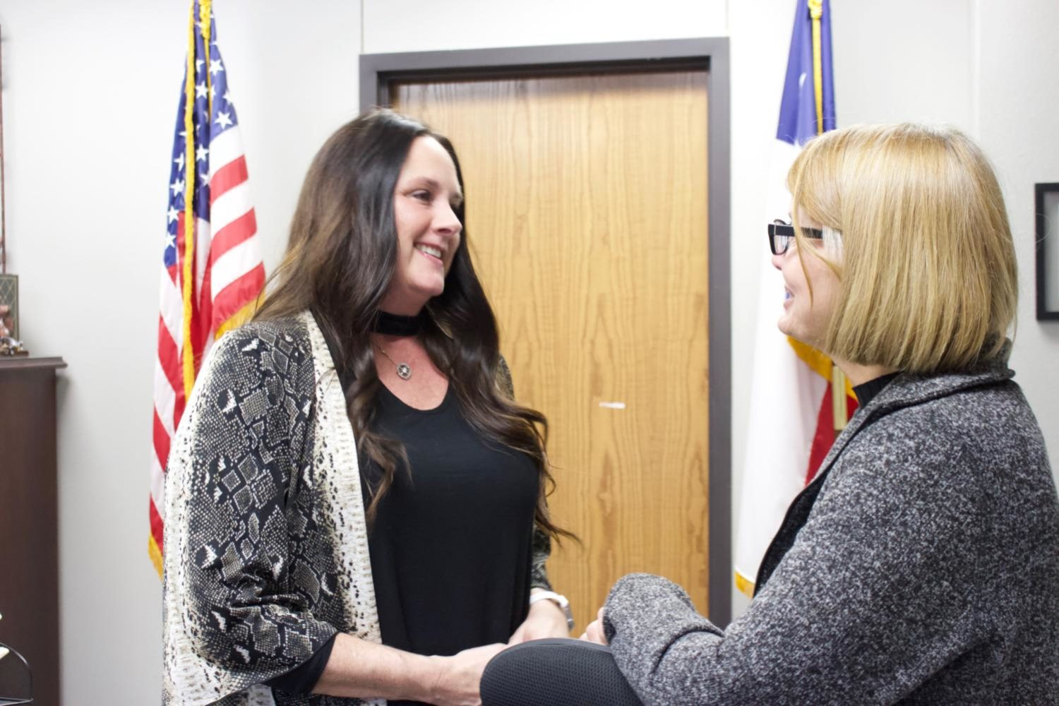 Coppell High School administrative assistant to the principal Amy Stroh talks with CHS administrative assistant to associate principals Lynn Anderson. Stroh's promotion came after the former principal's secretary, Terry Phillips, retired in December.