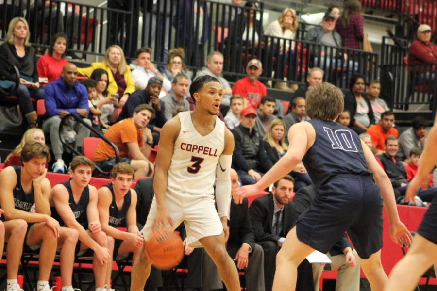 Coppell+senior+Tariq+Aman+looks+for+an+opening+during+the+Cowboys%E2%80%99+game+against+Flower+Mound+on+Jan.+8.+The+Cowboys+return+to+District+6-6A+play+tomorrow+night+against+Hebron+at+the+Coppell+High+School+arena.