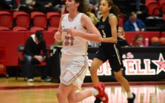 Cowgirls fight to the end, take a loss at first district game
