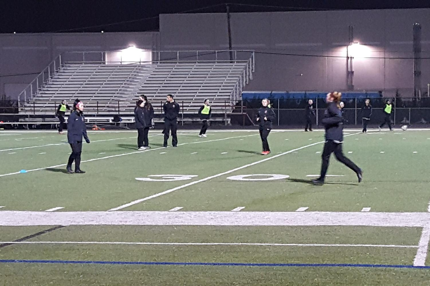 The Coppell girls soccer team warms up for its game against Paschal on Tuesday at CHS9 Lesley Field. Coppell would go on to win the game, 5-0, after goals from freshman forward Michelle Pal (2), sophomore midfielder Maya Ozymy, sophomore forward Jocelyn Alonzo and freshman midfielder Bailey Peek.