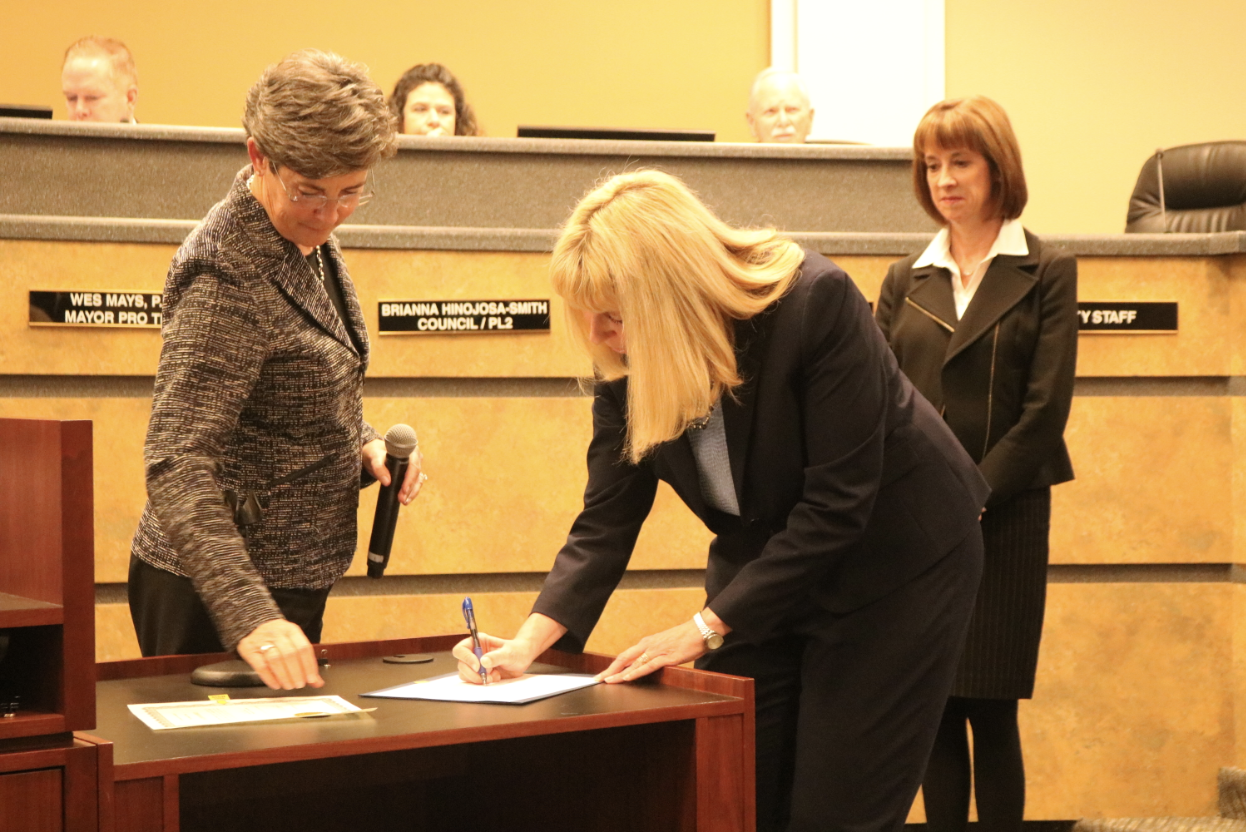 Kristine Schwan Primrose signs the motion sent in place to appoint her as the alternate municipal judge during the Coppell City Council Meeting on Jan. 8. Judge Primrose was selected after the current municipal judge Terry Landwehr received a higher position.