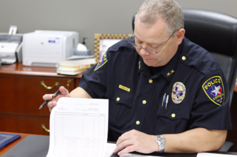 Coppell Police Chief Danny Barton looks through paperwork in his new office at the Coppell Police Station on Dec. 14. Barton has been a part of the police force for more than 20 years and was sworn in as Coppell Police Chief on Dec. 3.