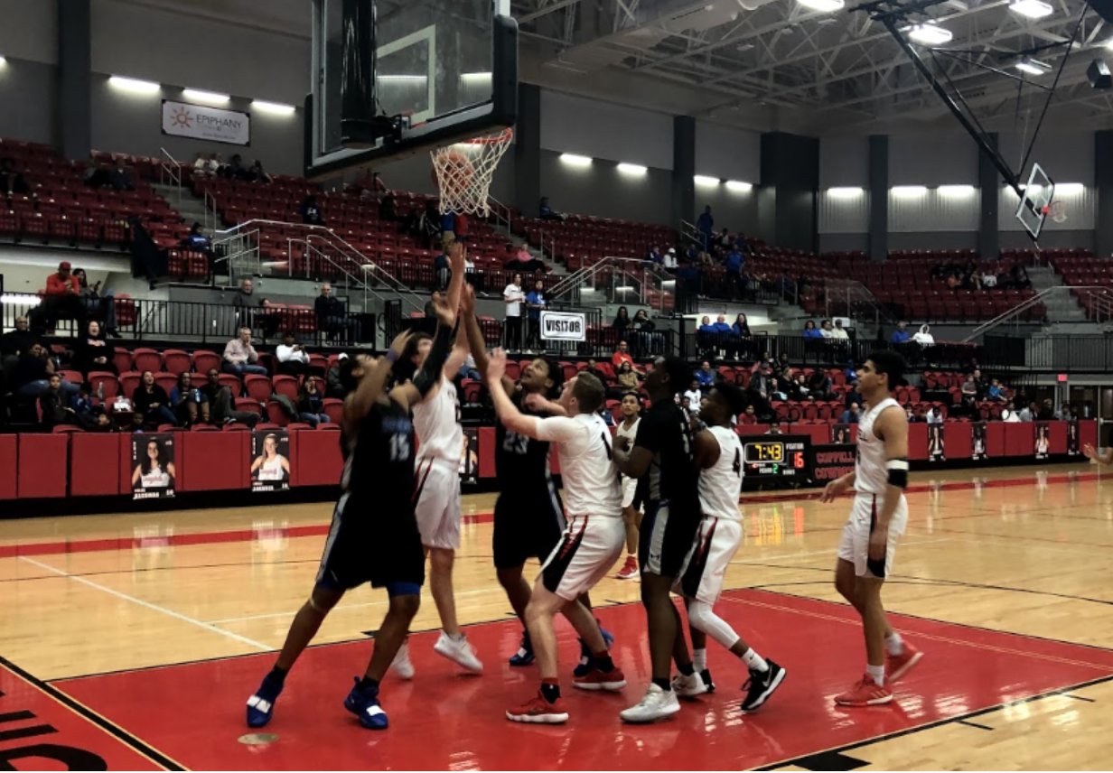 In the final moments of the second quarter in Friday's game, the Coppell Cowboys and Hebron Hawks struggle for possession of the ball in the Coppell High School arena. The Cowboys defeated the Hawks, 50-43, in their seventh district game.