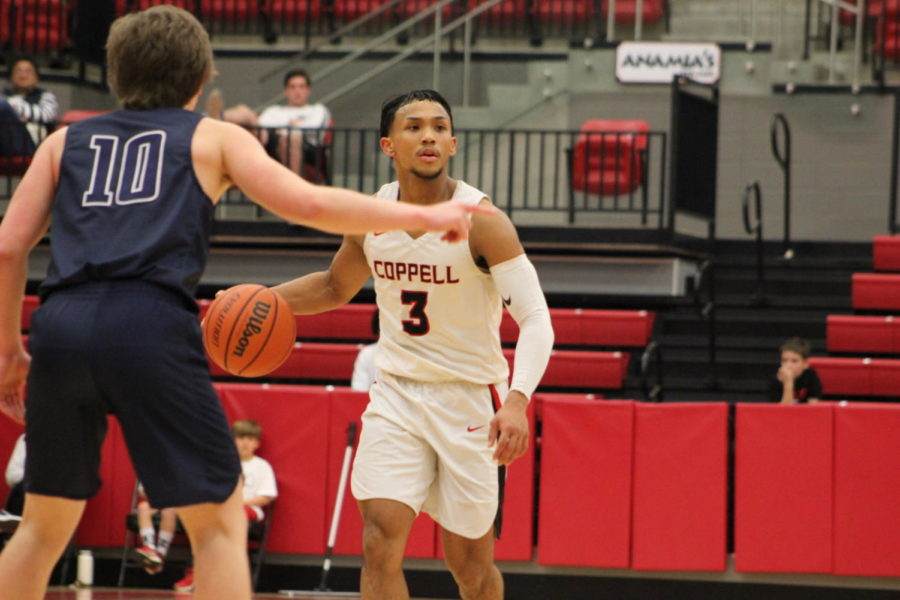 Coppell High School senior Tariq Aman dribbles the ball up the court last Tuesday against Flower Mound. The Cowboys defeated Irving-Nimitz, 57-49, at Nimitz High School.