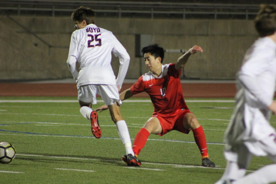 Coppell High School junior, Ben Wang guards against McKinney Boyd during the game on Jan.15th against McKinney Boyd, at Buddy Echols Field. Cowboys lost the battle to the Broncos 3-2.