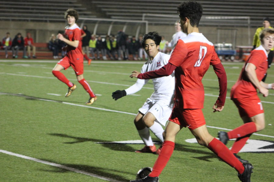 Coppell senior, Caleb Razo runs the ball past McKinney Boyd during the game on Jan.15th against McKinney Boyd, at Buddy Echols Field. The Cowboys play Flower Mound on Friday at 7:30 p.m. at Buddy Echols Field.