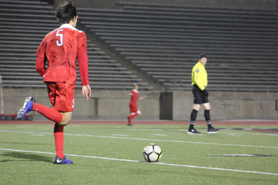 Coppell High School senior, Nathan Hernandez runs the ball to the goal during the game on Jan.15th against McKinney Boyd, at Buddy Echols Field. Cowboys lost the battle to the Broncos 3-2.