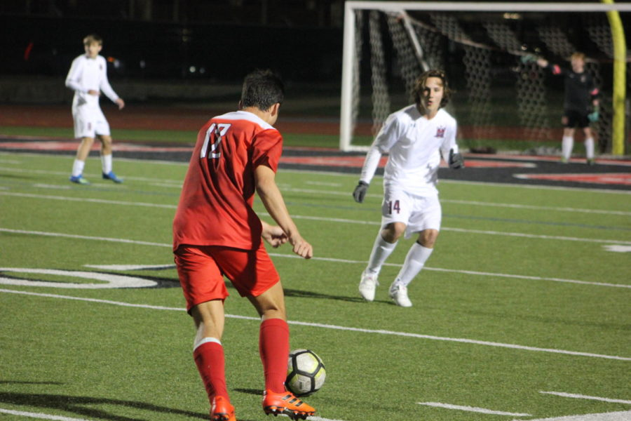 Coppell High School senior Justin Chow shoots for a goal during the game on Jan.15th against McKinney Boyd, at Buddy Echols Field. Cowboys lost the battle to the Broncos 3-2.