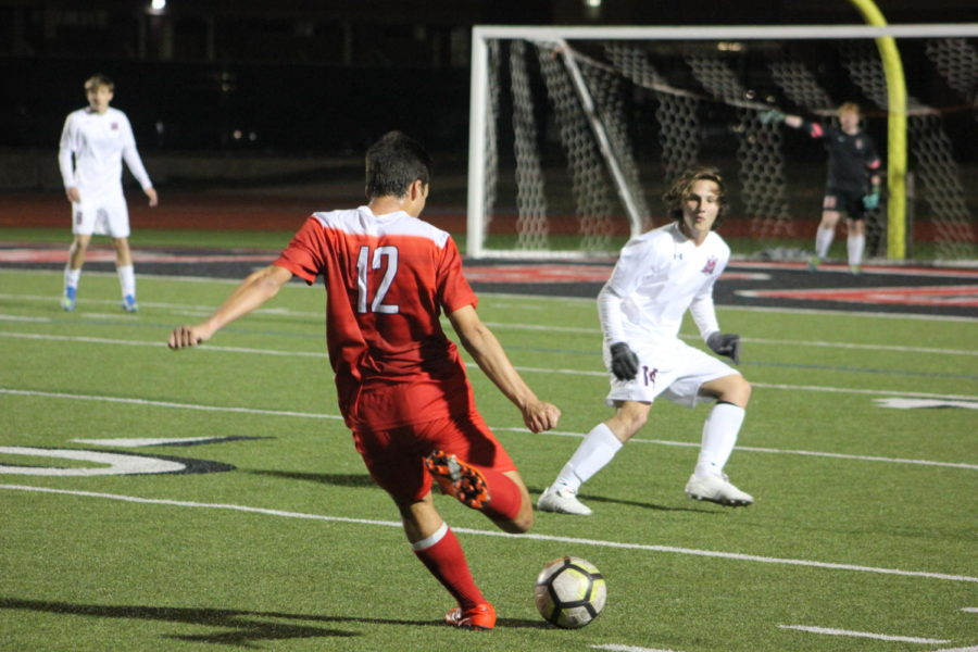 Coppell+High+School+senior+Justin+Chow+shoots+for+a+goal+during+the+game+on+Jan.15th+against+McKinney+Boyd%2C+at+Buddy+Echols+Field.+Cowboys+lost+the+battle+to+the+Broncos+3-2.