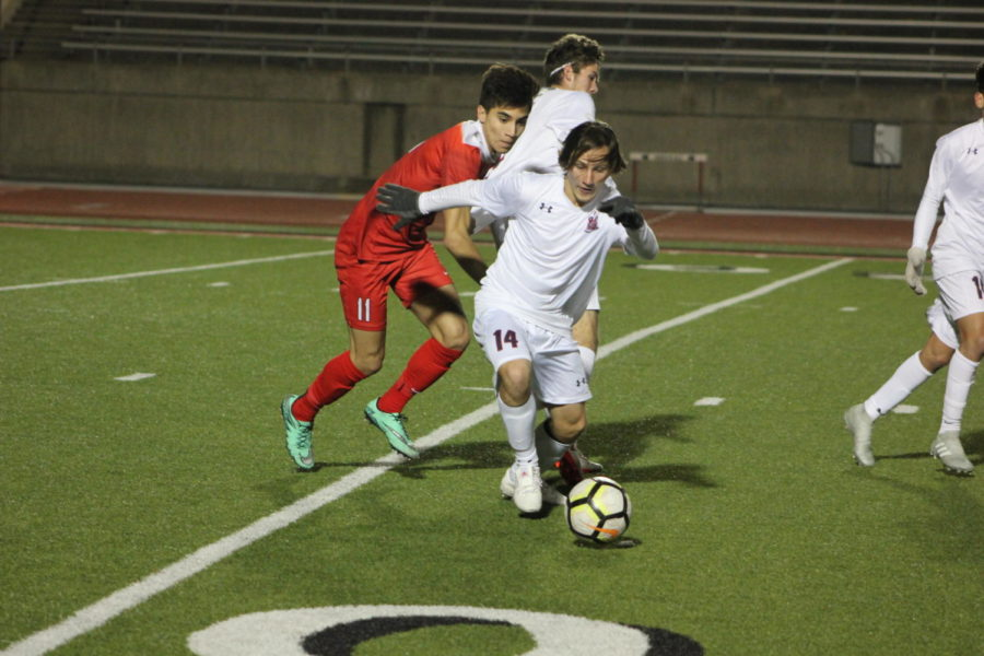 Coppell High School senior Jacob Vasquez goes against McKinney Boyd to retrieve the ball during the game on Jan.15th against McKinney Boyd, at Buddy Echols Field. Cowboys lost the battle to the Broncos 3-2.