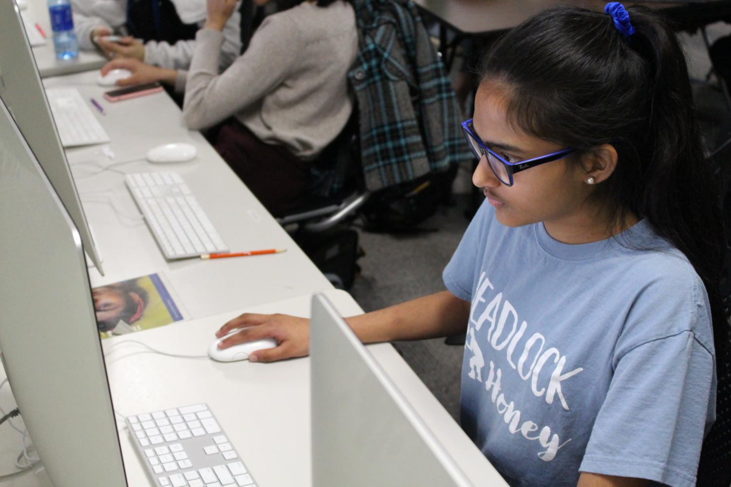 The Sidekick staff writer Neha Desaraju edits a story on Thursday in the newsroom. Desaraju enjoys writing for The Sidekick as well as contributing ideas to help the program's  content grow.