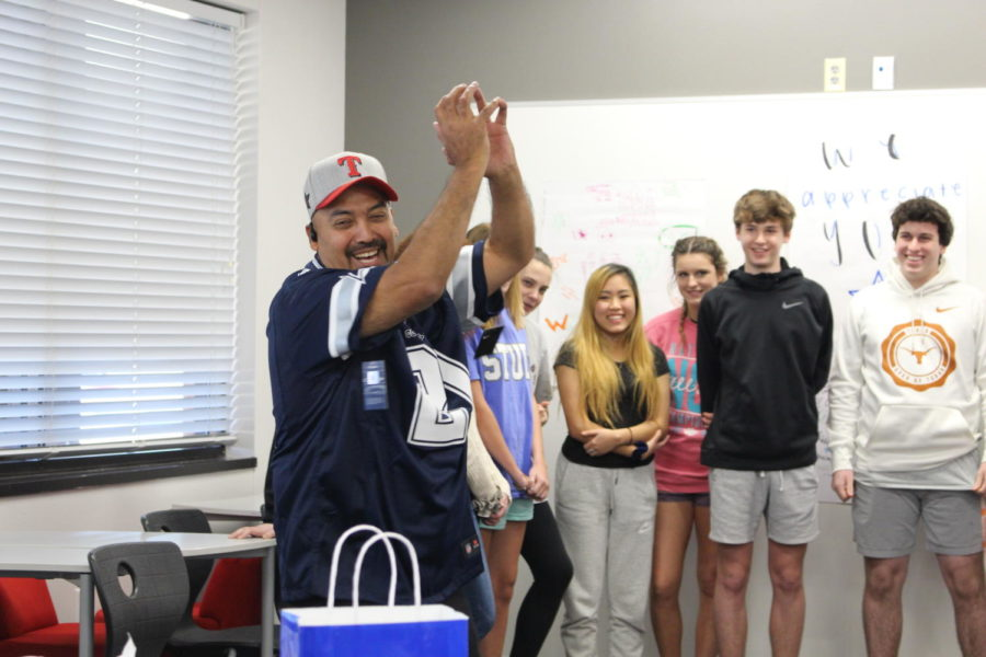 CHS9 teacher Christie Nelson's sixth period Spanish II class surprises custodian Jose Rodrigues with posters of appreciation. Rodrigues has worked for Coppell ISD for nearly 30 years.