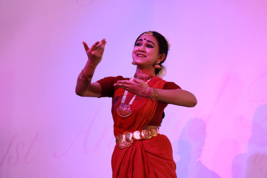 Coppell High School senior Bhargavi Sarangapani performs the classical dancing in Beulah Sapphire Silks at Shots by Bhavya 1st Annual Fashion at Ervay Theater on Feb. 10. Coppell High School senior  Bhavya Vasireddy presents a cultural fashion show with designers in the metroplex.