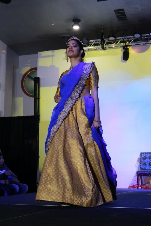 Coppell High School sophomore Shaksi Sharma walks the runway in Beulah Sapphire Silks at Shots by Bhavya 1st Annual Fashion at Ervay Theater on Feb. 10. Coppell High School senior Bhavya Vasireddy presents a cultural fashion show with designers in the metroplex.