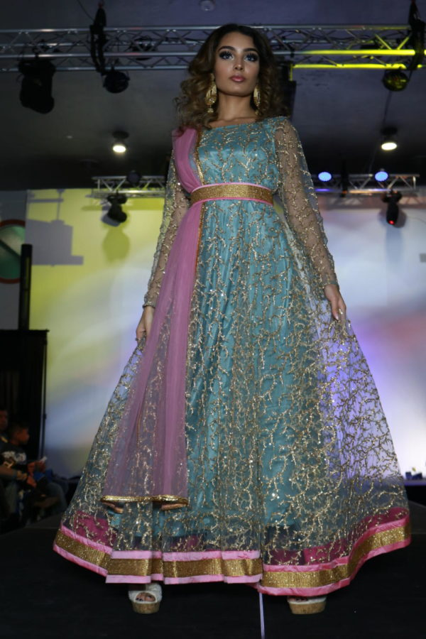 Coppell High School senior Kamakshi Sharma walks the runway in HoneyBee Handlooms at Shots by Bhavya 1st Annual Fashion at Ervay Theater on Feb. 10. Coppell High School senior Bhavya Vasireddy presents a cultural fashion show with designers in the metroplex.
