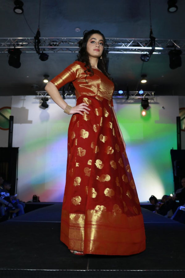 Coppell High School senior Mursal Naimi walks in the runway in Fashion Fiesta at Shots by Bhavya 1st Annual Fashion at Ervay Theater on Feb. 10. Coppell High School senior Bhavya Vasireddy presents a cultural fashion show with designers in the metroplex.