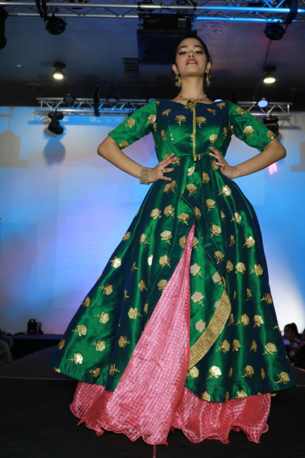 Coppell High School sophomore Shaksi Sharma walks the runway in Fashion Fiesta at Shots by Bhavya 1st Annual Fashion at Ervay Theater on Feb. 10. Coppell High School senior Bhavya Vasireddy presents a cultural fashion show with designers in the metroplex.