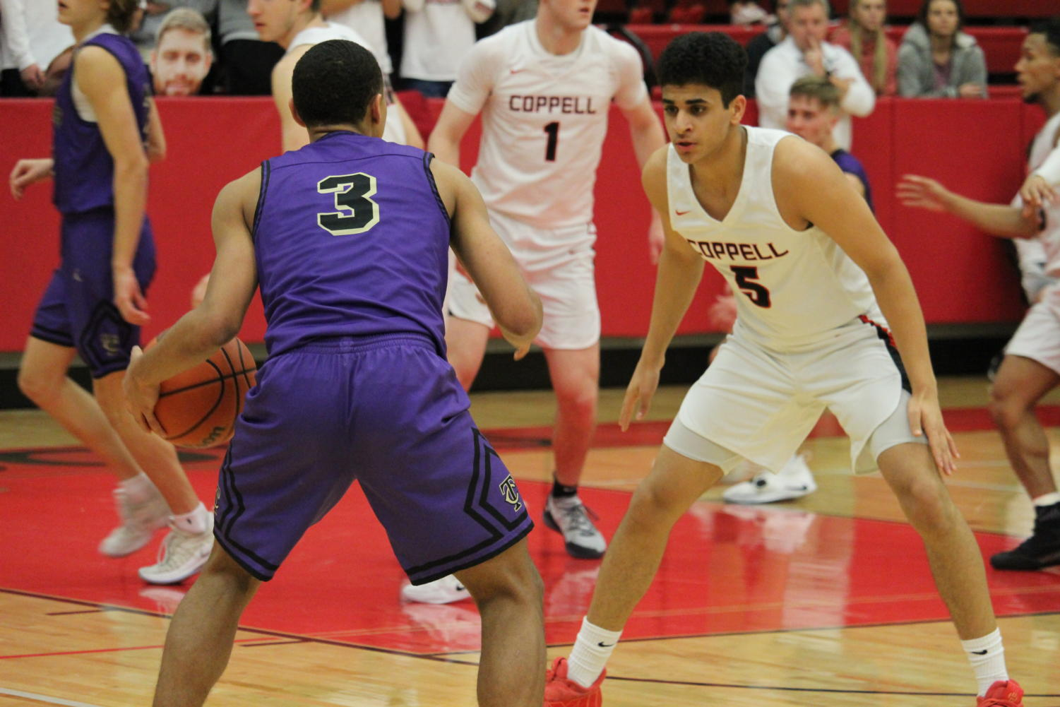 Coppell junior Adam Moussa guards the ball against Keller Timber Creek on Feb. 19, at CHS Arena. Moussa shot a three in the final 20 seconds of the BI-District Playoffs to send the Cowboys to a 53-51 win. The Cowboys are moving on to the Championship against Lake Ridge on Feb. 21.