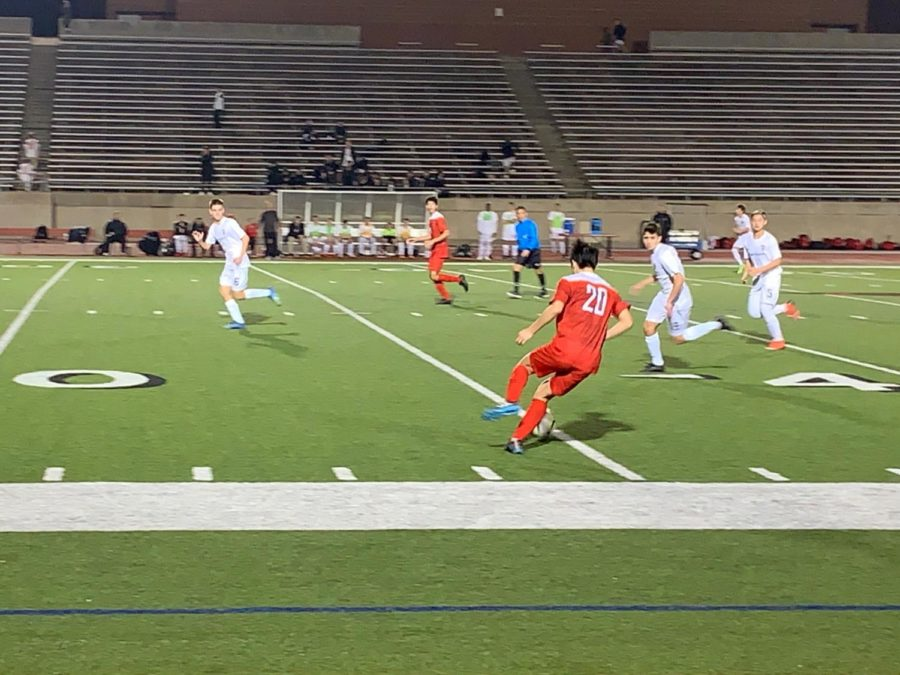 Coppell+High+school+senior+defender+Dail+Kang+cuts+the+ball+back+while+the+Cowboys+attack.+Coppell+lost+3-2+to+Marcus.