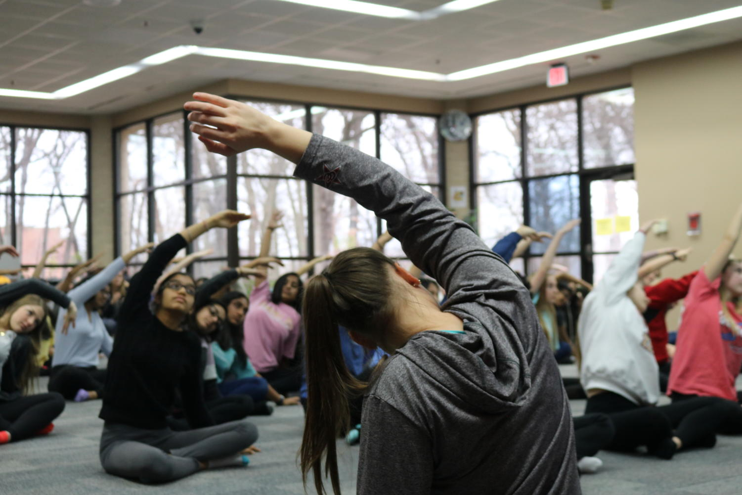 During sixth period on Thursday, Coppell High School psychology students do yoga to enhance their understanding of their Overall Development unit in the library. The yoga is conducted by Kristia Leyendecker and Eric Walker.