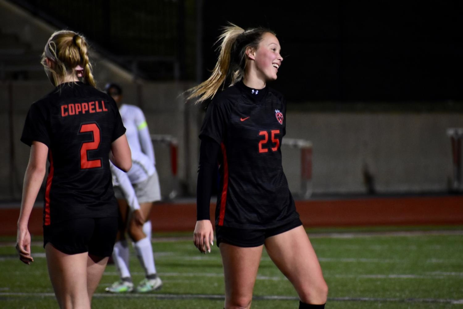 Coppell senior forward/midfielder Micayla Weathers celebrates with teammates after scoring a goal during the game against Lewisville on Jan. 29 at Buddy Echols Field. The Cowgirls won, 5-1, and play Irving tomorrow