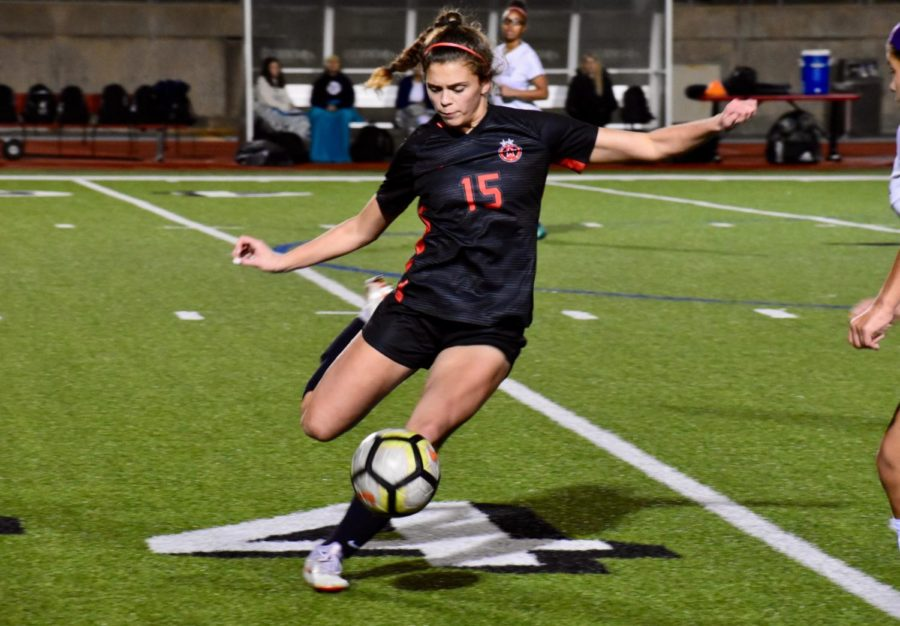 Coppell+junior+midfielder%2Fdefender+Katie+Odum+kicks+the+ball+to+pass+to+her+teammate+during+the+game+against+Irving+Nimitz+on+Tuesday+at+Buddy+Echols+Field.+The+Cowgirls+won+with+a+score+of+6-1+as+they+move+on+to+play+MacArthur+next+Tuesday+on+Feb.+19.