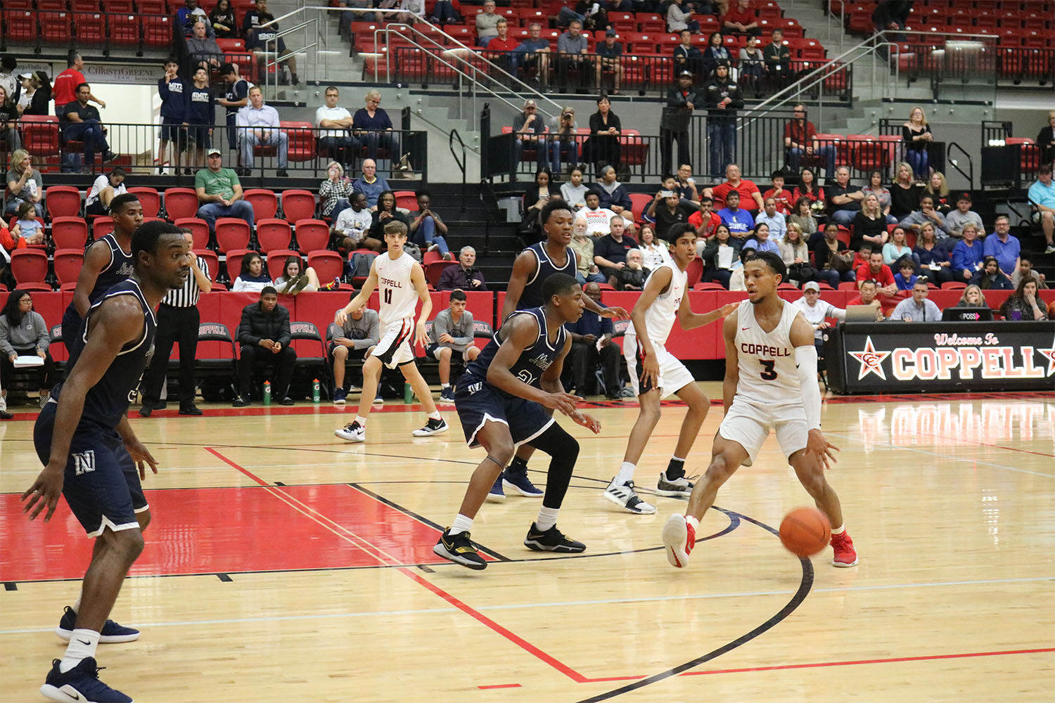 Coppell High School senior Tariq Aman searches for a gap on Tuesday against Irving Nimitz. The Cowboys defeated the Vikings, 60-39.