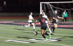Cowgirls tame Lady Tigers, remain undefeated in district