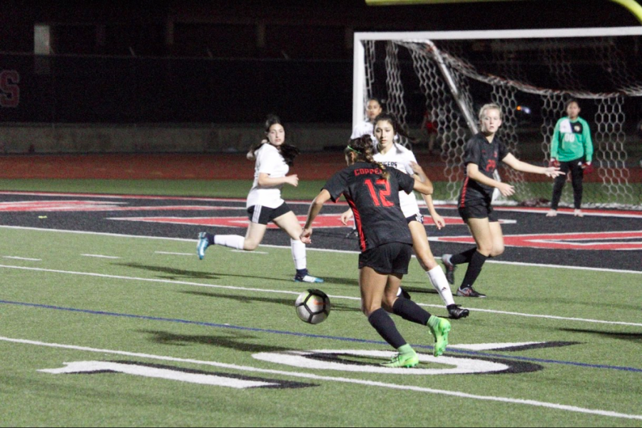 Coppell+sophomore+midfielder+Jocelyn+Alonzo+takes+a+goal+during+the+match+against+Irving+at+Buddy+Echols+Field+on+Feb.+5.+The+Cowgirls+won%2C+4-0.